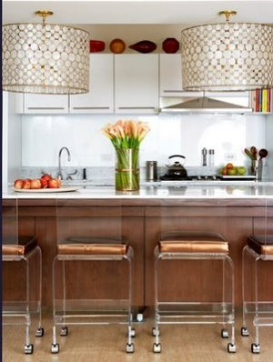 Kitchen with lucite barstool and drum chandeliers