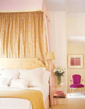 Deep cream bed with hot pink and drapery headboard