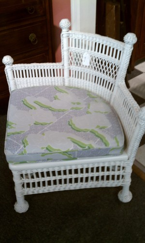 Corner wicker chair with pie piece cushion