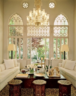 Arched windows, cream and white with wood accents