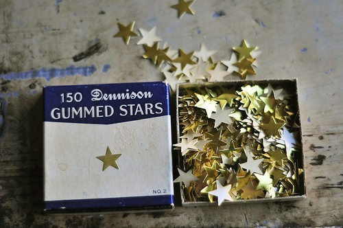 Girl Hula gold stars in blue box