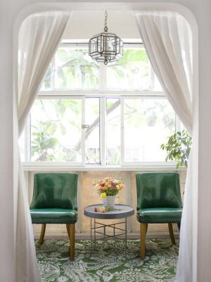 green chairs and carpeting with white drapery emily henderson