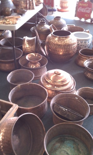 Rows of brass pots