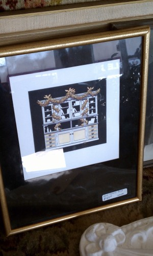 Black and white and gold framed picture