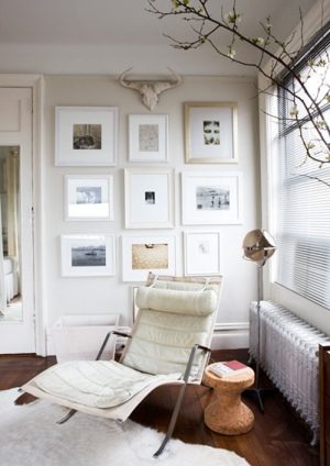 Melanie Acevedo via Style File white walls and art