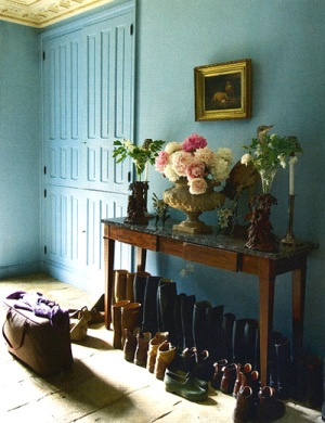 Turquoise walls with rows of boots
