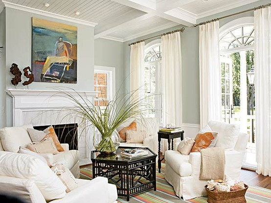 Coral and blue family room with coffered ceiling