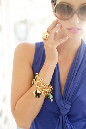 Royal blue draped dress with gold charms