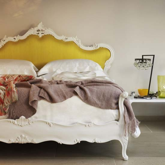 White bed with yellow upholstered