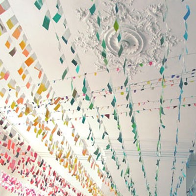 Rainbow streamers on white ceiling