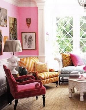 Pink interior with orange chevron chair