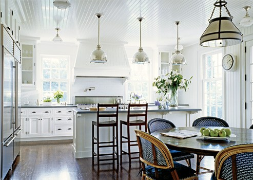 White kitchen with eat in dining space and bistro chairs