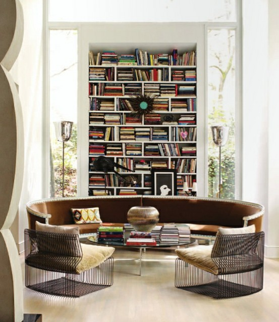 Round banquette with bookcases and metal chairs