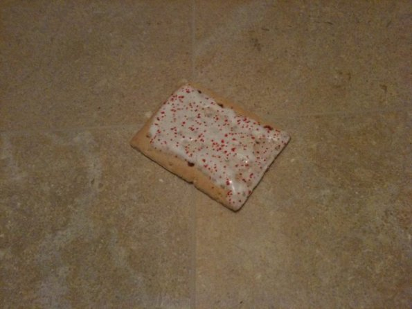 Strawberry pop tart on limestone floor