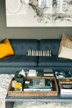Dark sofa with bright yellow pillow