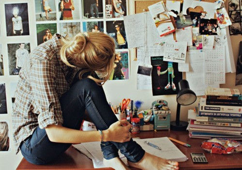 Girl on desk getting organized