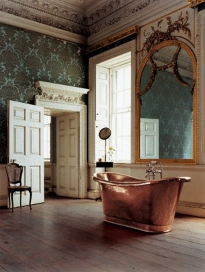 Copper tub in traditional bathroom with teal wallpaper