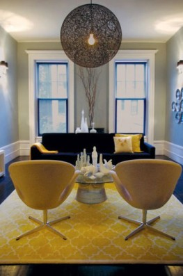 blacks sofa with yellow rug and chairs via apartment therapy
