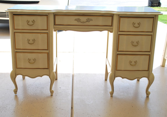yellow painted antique desk before