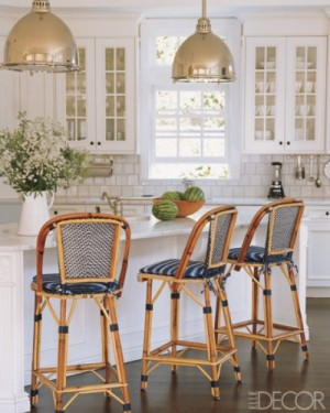 Elle decor black and tan bar stools in white kitchen