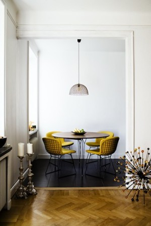 black dining room floor with gold chairs via emmas blogg