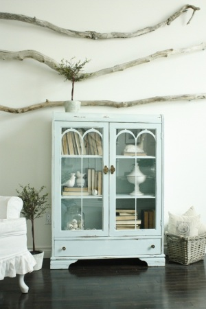 Blue cabinet with books turned backwards
