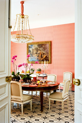 pink dining room with black and white mosaic wall to wall carpeting