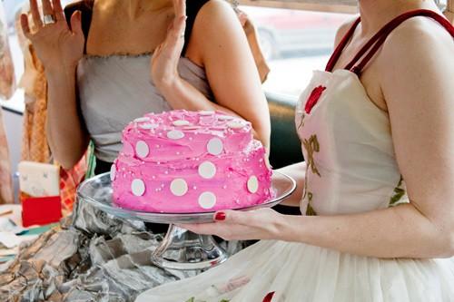 Pink polka dot cake with vintage dresses