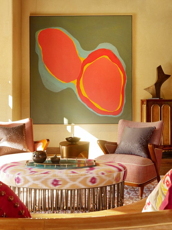 ikat ottoman with abstract artwork and accent chairs