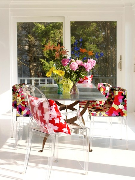 ghost chairs with red floral fabric