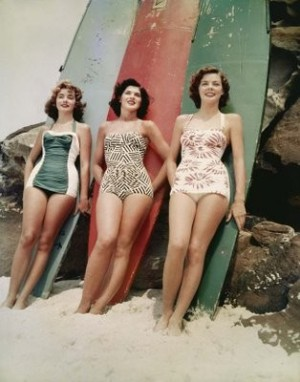 three ladies and surfboards
