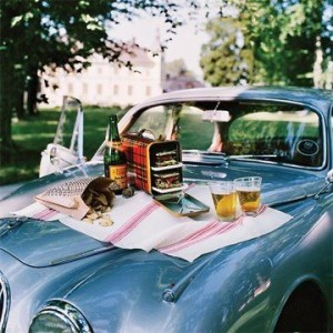 old vintage car with picnic via brown dress with white dots