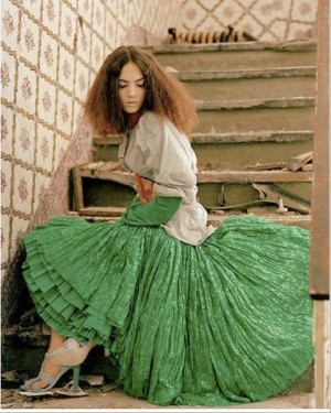 dariamirbach green flowy skirt with patterned wallpaper