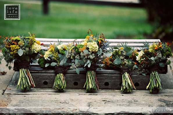 Bouquets all in a row Bluemont wedding Stephen Bobb