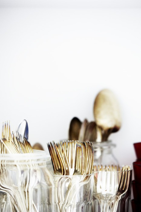 Gold flatware in clear jars