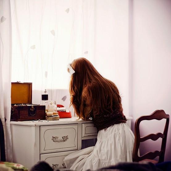 Girl at desk in white skirt