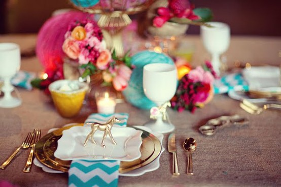 Gold flatware, turquoise chevron and hot pink flowers