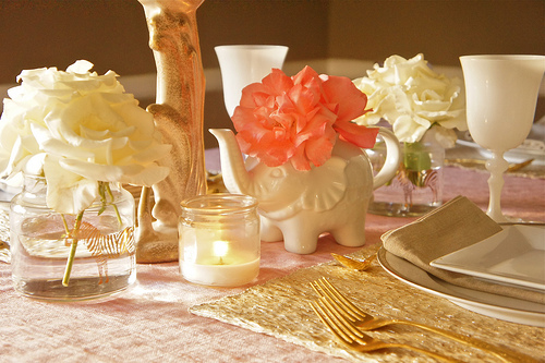 gold flatware with white and coral accents