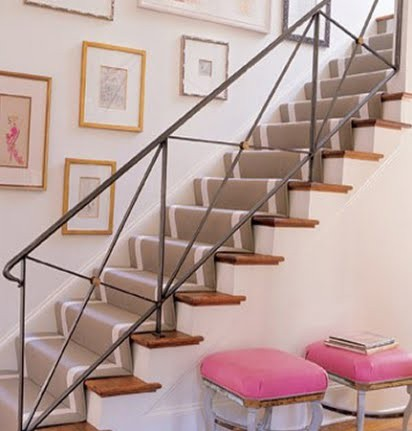 Staircase with black railing and pink accents