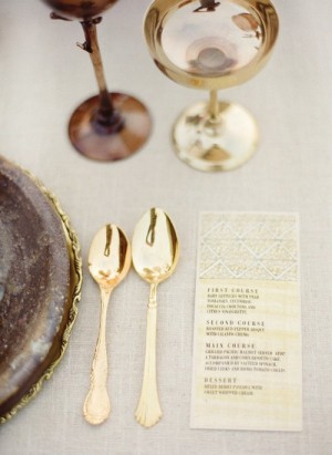 Close up of table setting with gold flatware