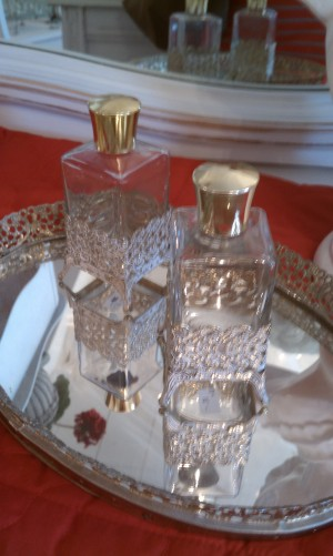 Perfume bottles and mirrored tray