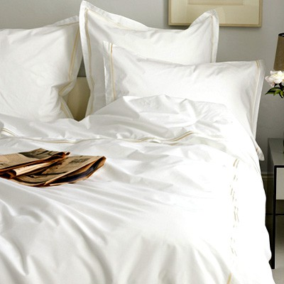 White bed with newspaper