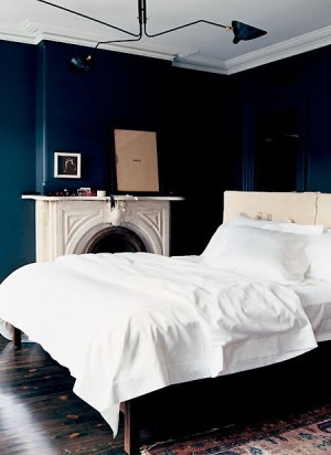 Jenna Lyons bedroom navy walls and white bed