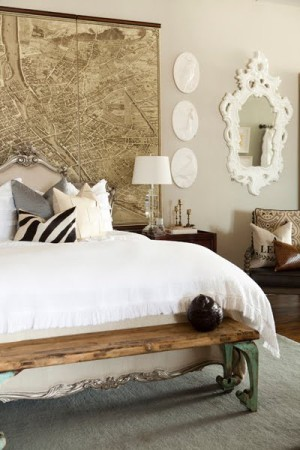 white bedroom with map and zebra pillow