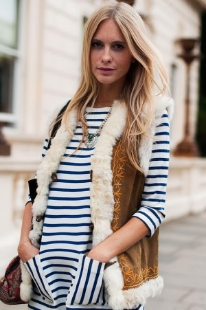 Blonde girl with shearling vest and striped shirt