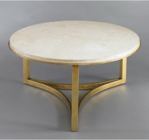 Milo table in travertine by DwellStudio
