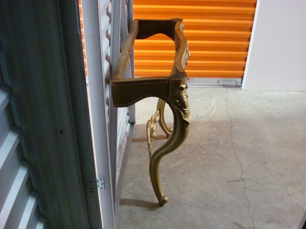 Gold console table side view
