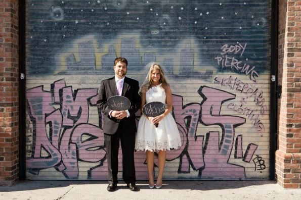 Beth and Jeremy Boardwalk pictures just hitched in front of graffiti