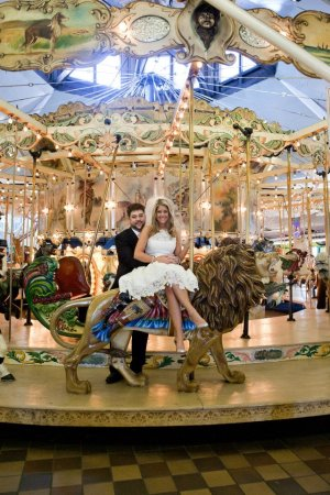 Beth and Jeremy Boardwalk pictures on a carousel