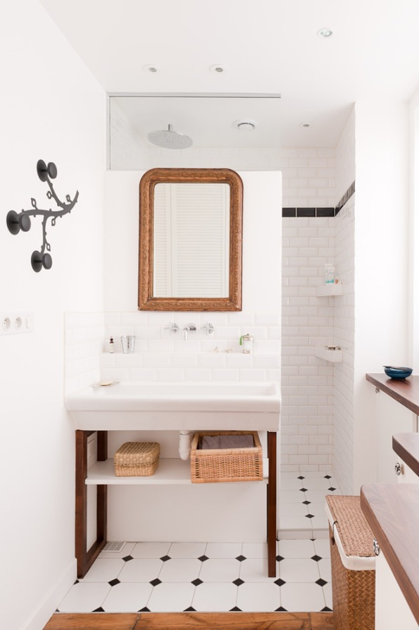 Paris apartment bathroom with wood and black and white